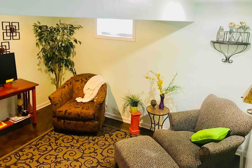 Cozy living space with flat screen tv & Roku. Guests enjoy hanging out in this area to catch up, play some good old fashioned board games or just to binge on some Netflix.