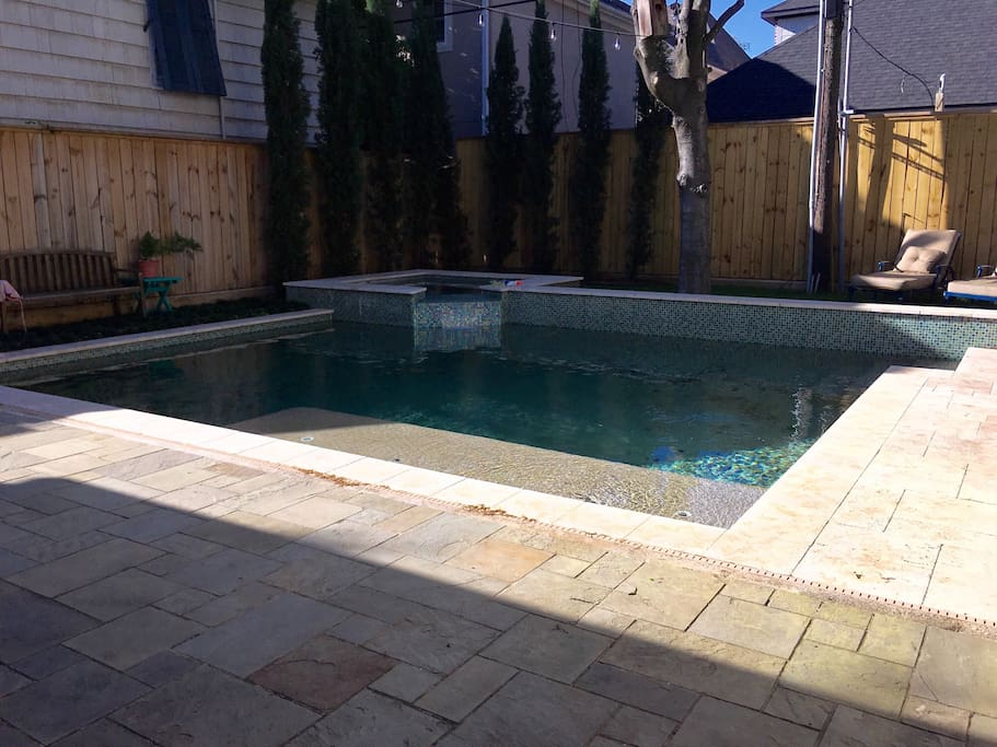 Gorgeous backyard! Slate and travertine patio, heated pool with tanning shelf and hot tub.