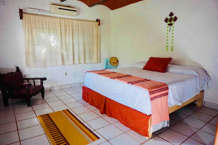 Great private room near the sea with A/C.