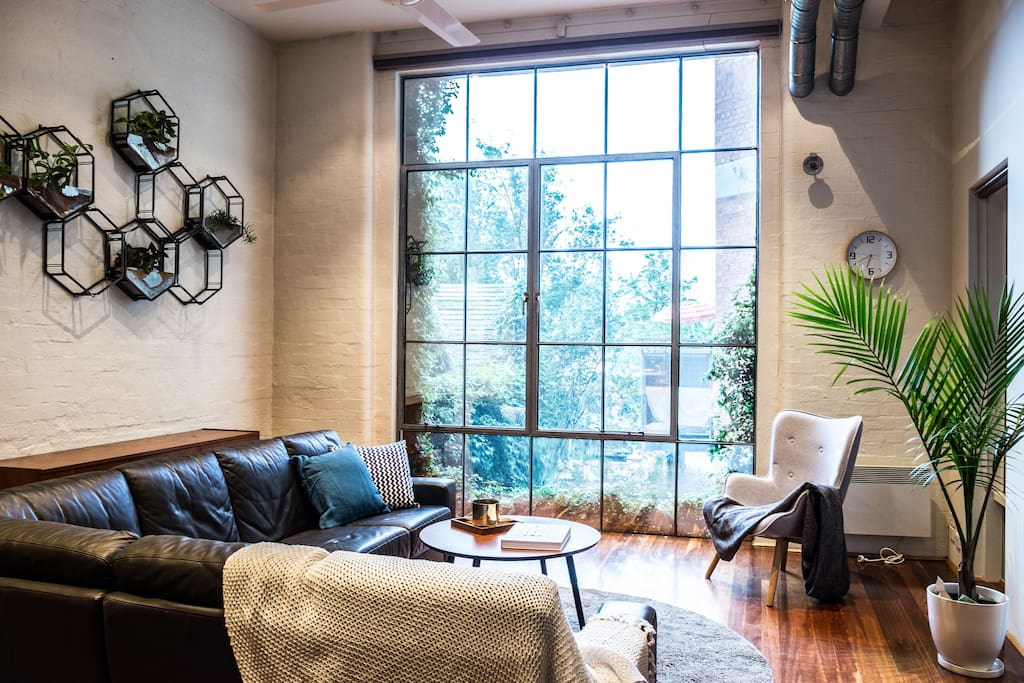 Enjoy the north facing, floor to ceiling industrial window. The incredible picture window spills light into the apartment throughout the day.