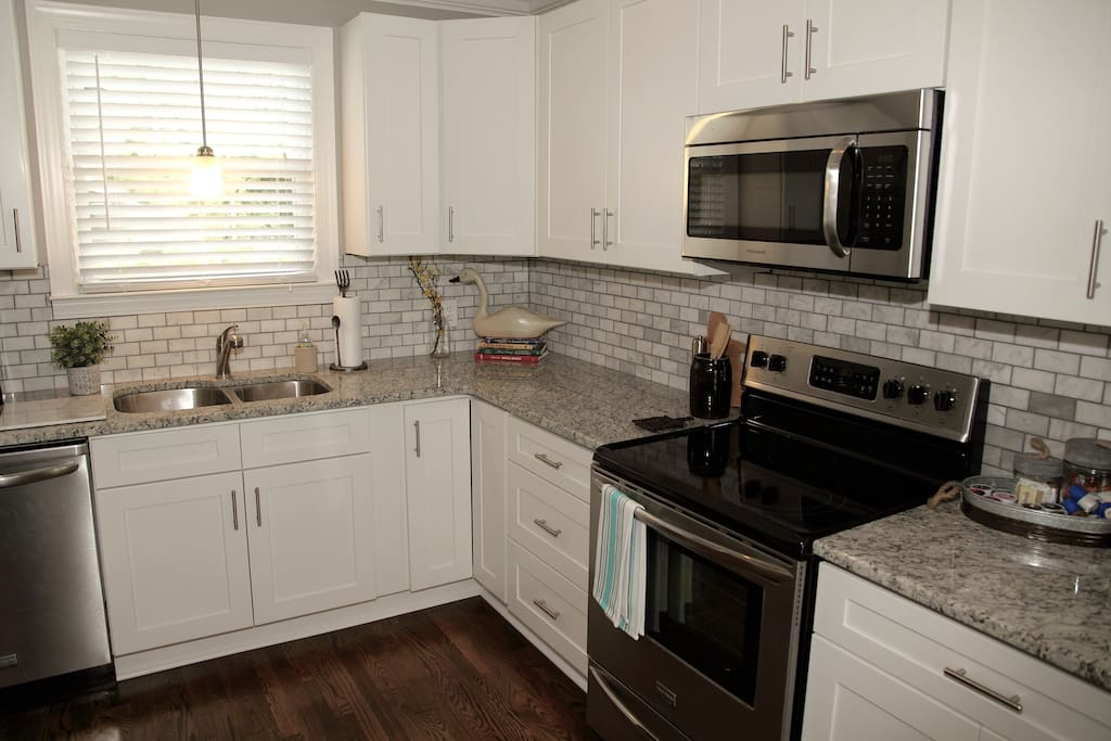 Brand new kitchen with granite counters and brand new hardwood floors. Make yourself at home in this fabulous kitchen.
