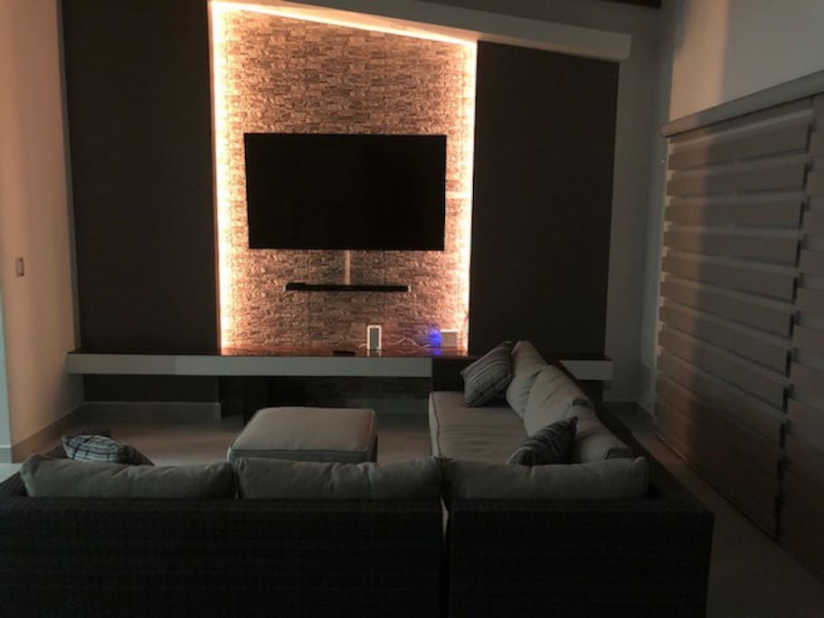 living room with 70' smart tv