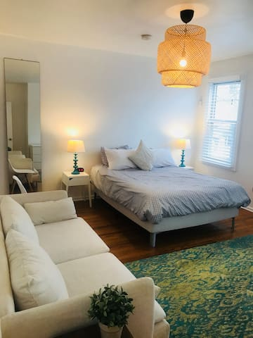 Master Bedroom, queen sized bed, large couch, dresser, and connected bathroom.  We also have an alarm clock that charges your phone using USB!