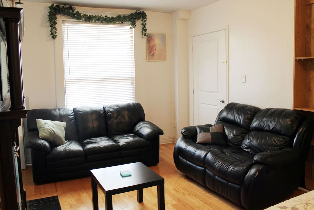 Genuine real leather sofas and hardwood floors. Sit back, sink in and relax.