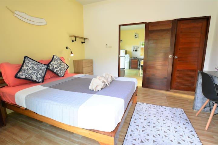 Bedroom with sliding doors onto outside terrace & en-suite bathroom