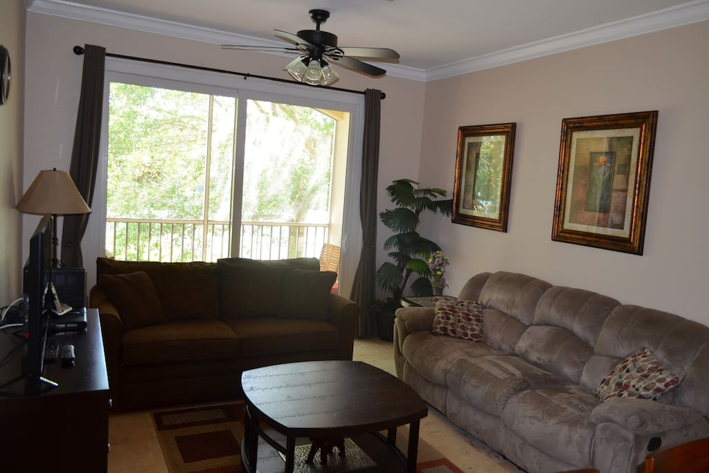 Great living room with Tons of seating and flat screen TV