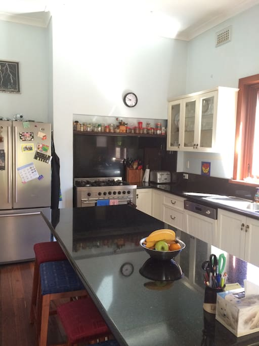 Well planned kitchen with breakfast bar, microwave under the bench, lovely big stove, dishwasher and French door fridge.