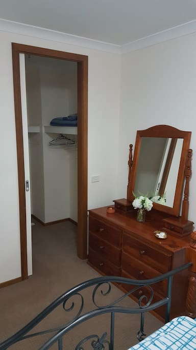 WALKIN ROBE WITH DRESSER AND MIRROR