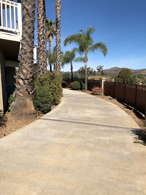 Take the driveway around toward the suite and parking