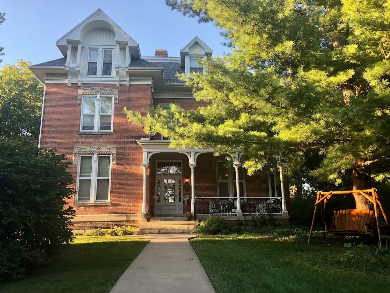 """External view of AyersMansionII - DeWolf Extended Suites, in """"mansion row"""" in historical, residential neighborhood of Jacksonville, Illinois."""
