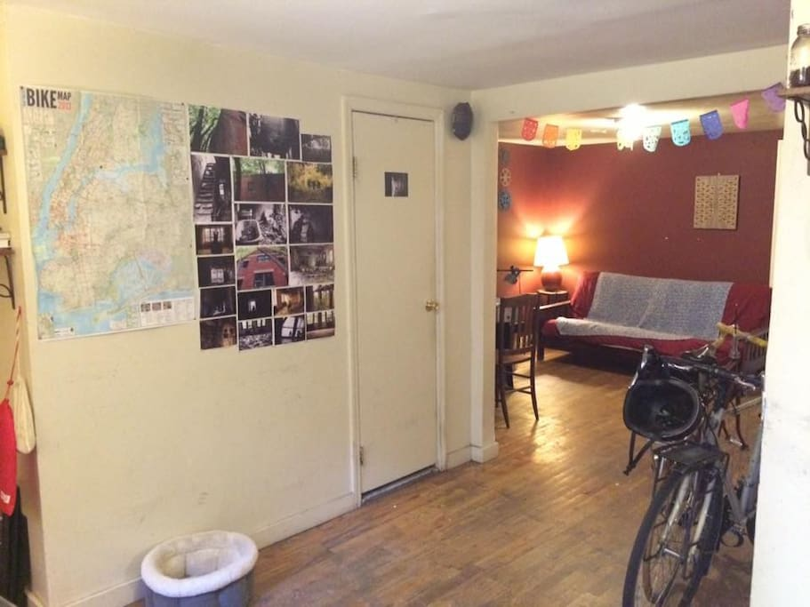 large NYC bicycle map to help you navigate on your cite-bike from the corner / futon for lounging in the shared space