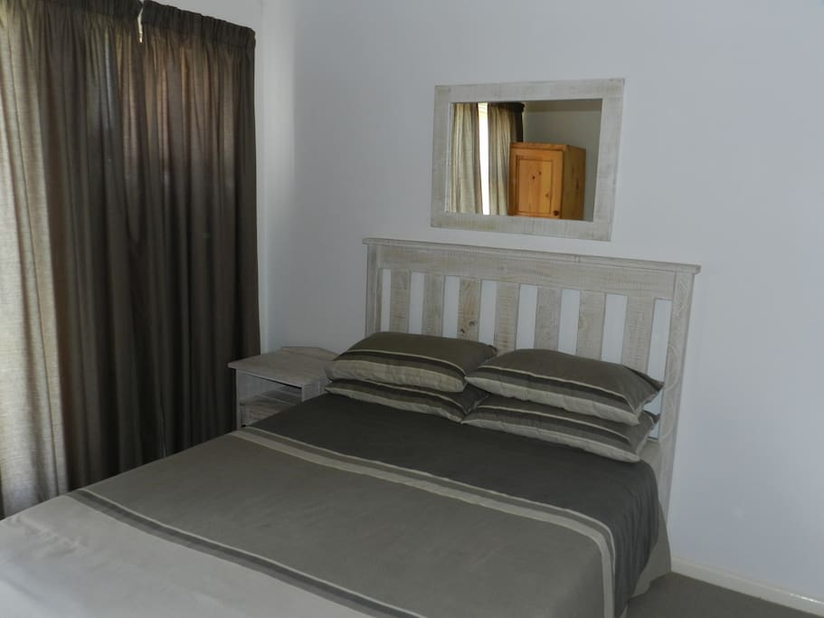 2x Bedrooms with double beds and ample cupboard space.