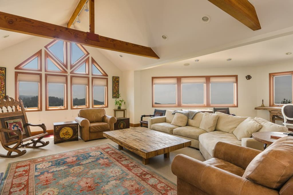 Entertainment room with beautiful ocean views, large screen tv, and plenty of games and movies