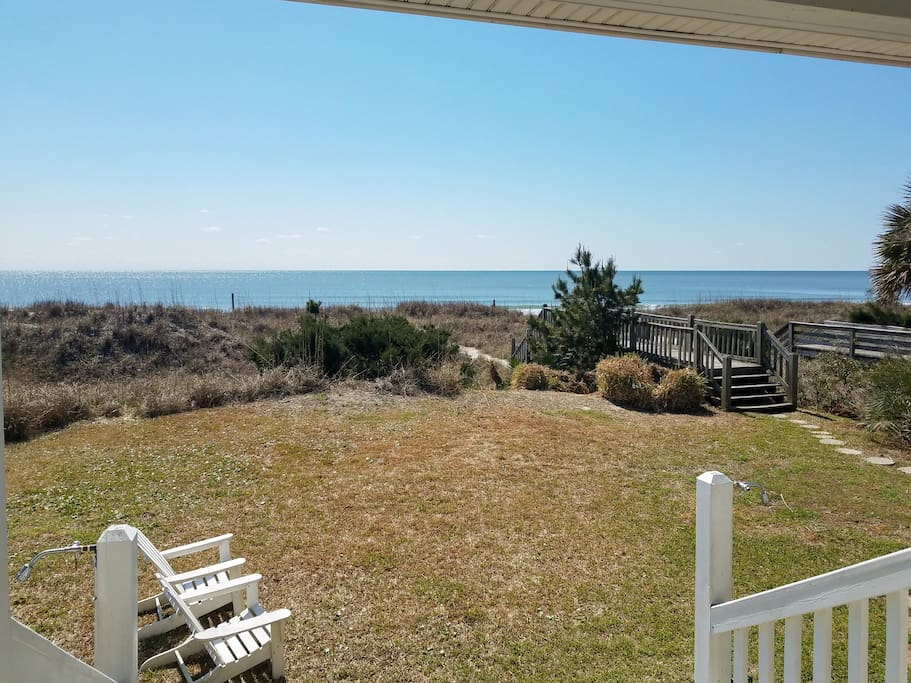 Step off your private deck and follow the path down to the beach.