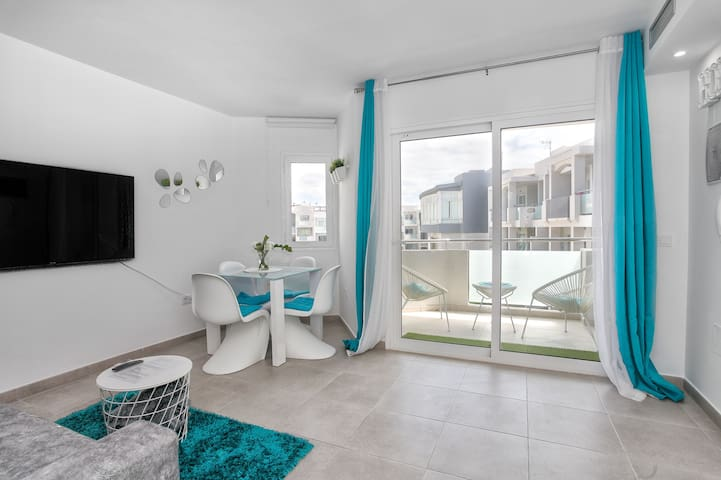 Elegant Apartment Close to Beach with Balcony, Pool, Terrace, Garden & Wi-Fi; Parking Available