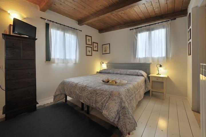 Appartamento Comfort con giardino,piscina,spa