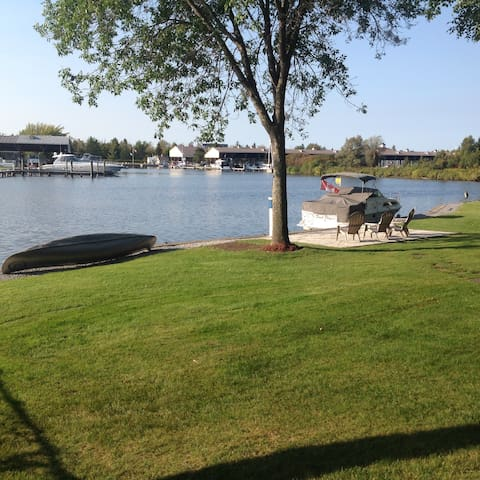 Large waterfront backyard with available canoe and kayak at no extra charge.