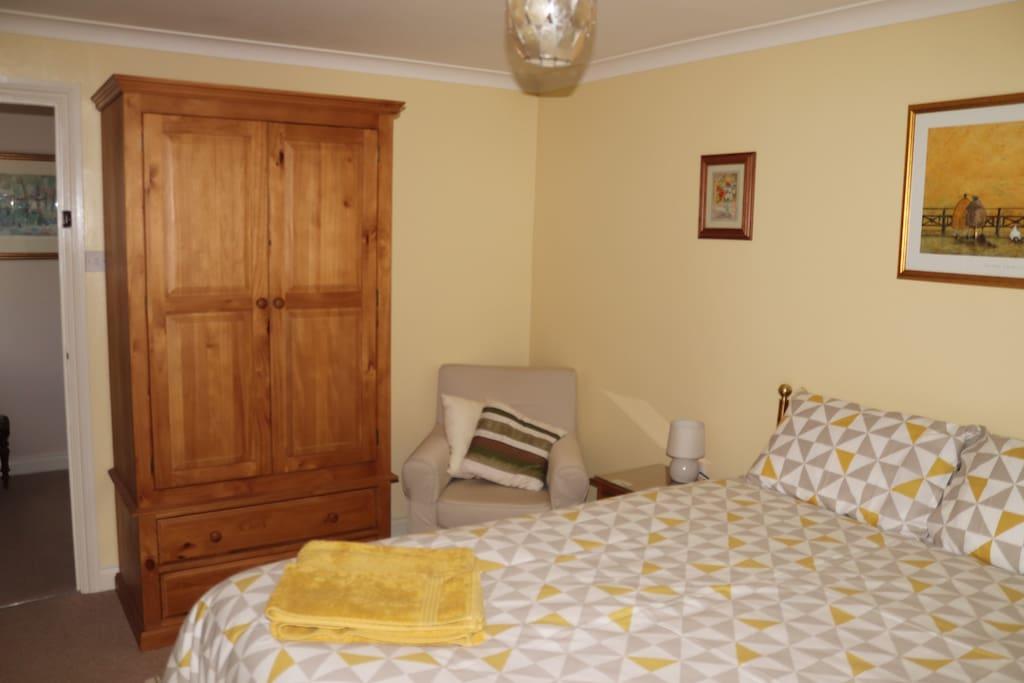 Room showing wardroom & armchair