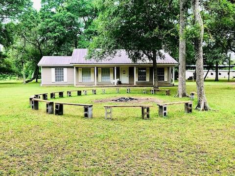 Farm Cottage Surrounded by Picturesque Live Oaks
