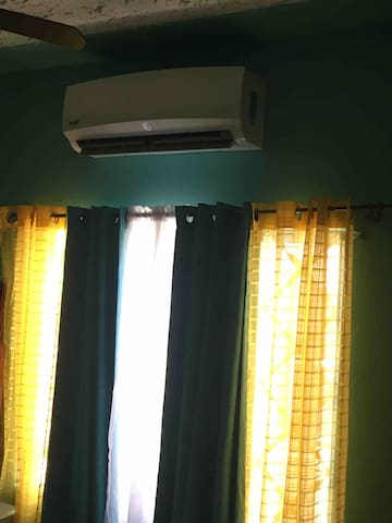 Ac in bedroom with king size bed