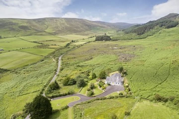Aerial view of our home and the surrounding wild Cooley hills.
