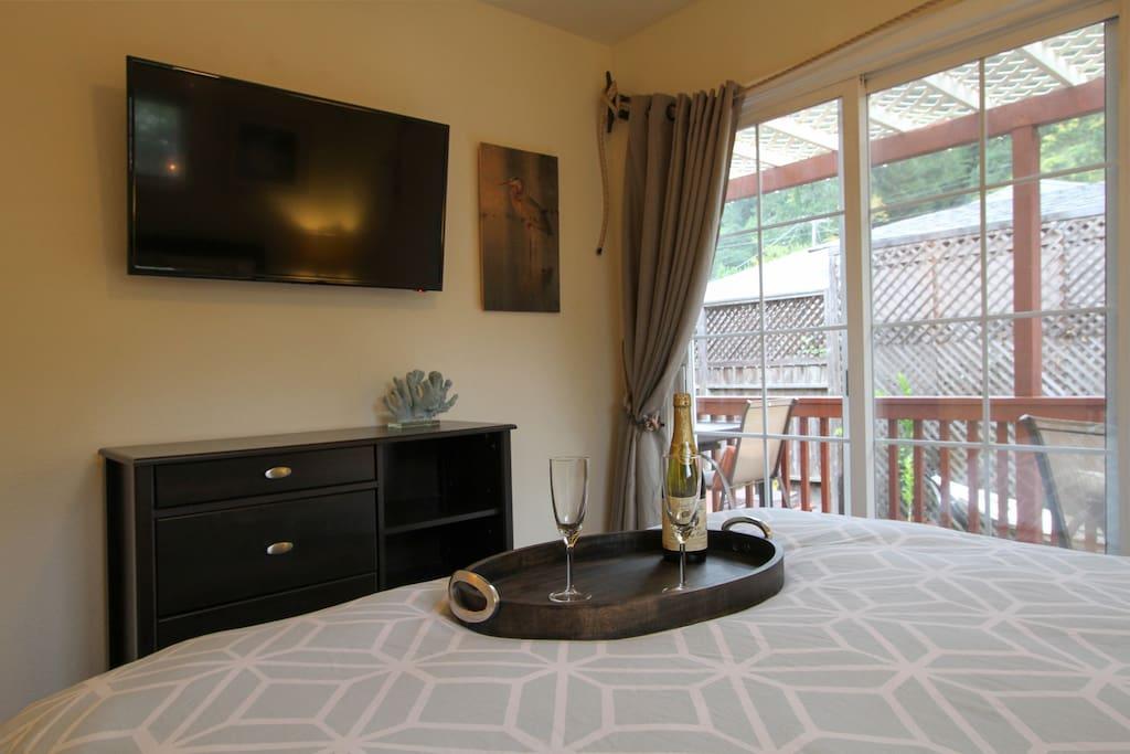 Smart TV and garden view from bedroom