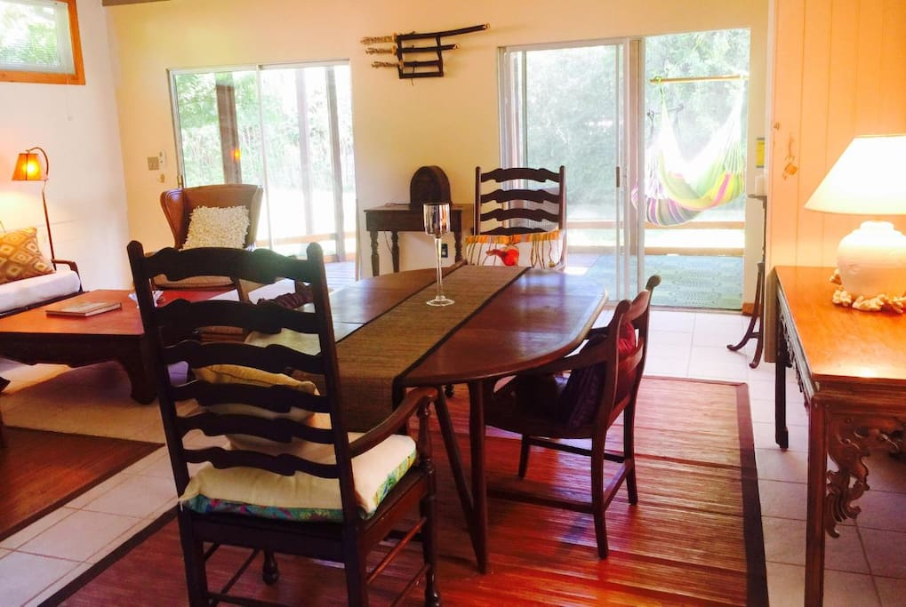Bright sunny living/dining room looking out to enclosed porch