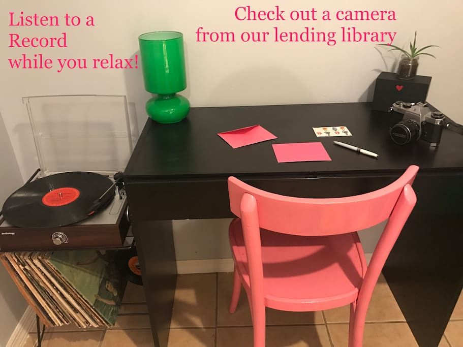 We offer a record player and choice records for your listening pleasure. We also have a camera lending library where you can check out a 35 mm camera or polaroid to take pictures while you're here to remember your trip!