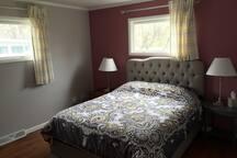 Master bedroom with Queen mattress.