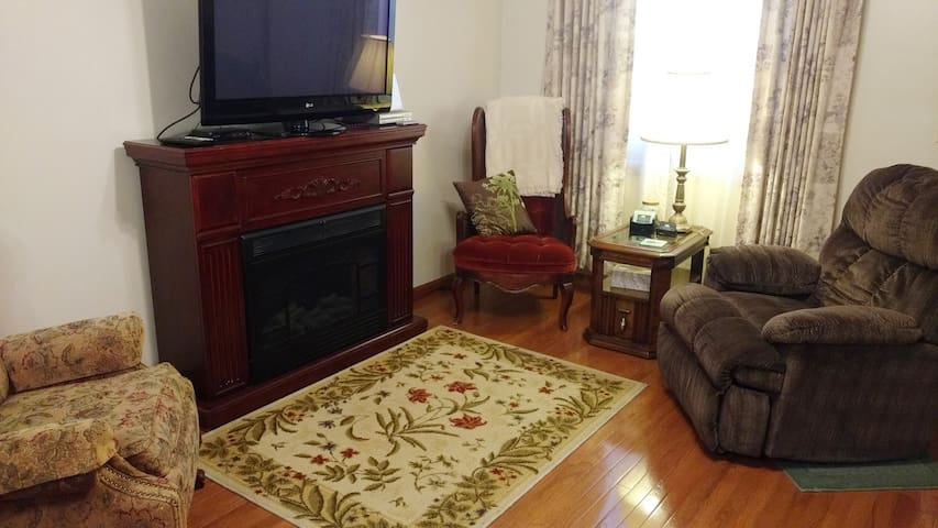 Living Room Includes Electric Fireplace and is Open with the Dining Room