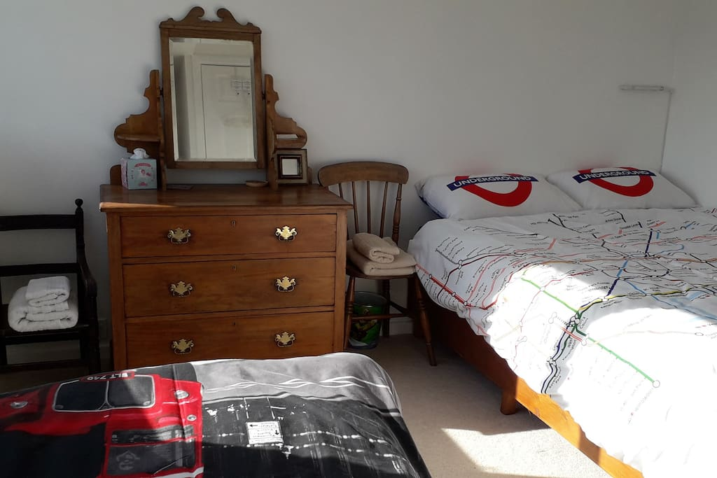 Upstairs guest bedroom, including a double and a single bed, adjacent to the upstairs bathroom
