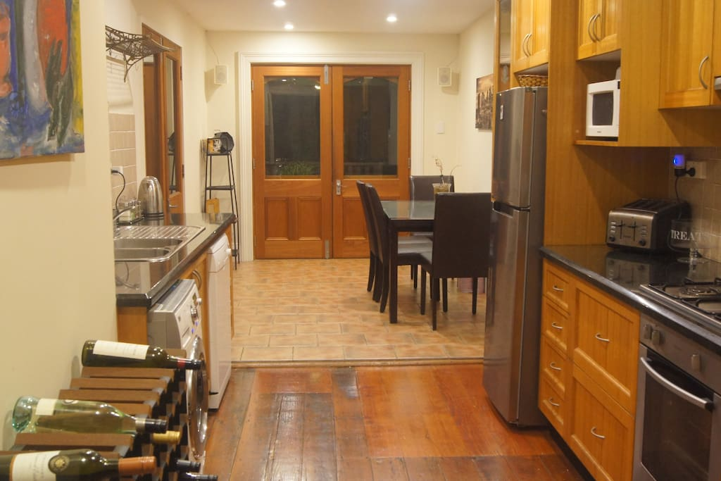 Long galley kitchen and spacious dining area