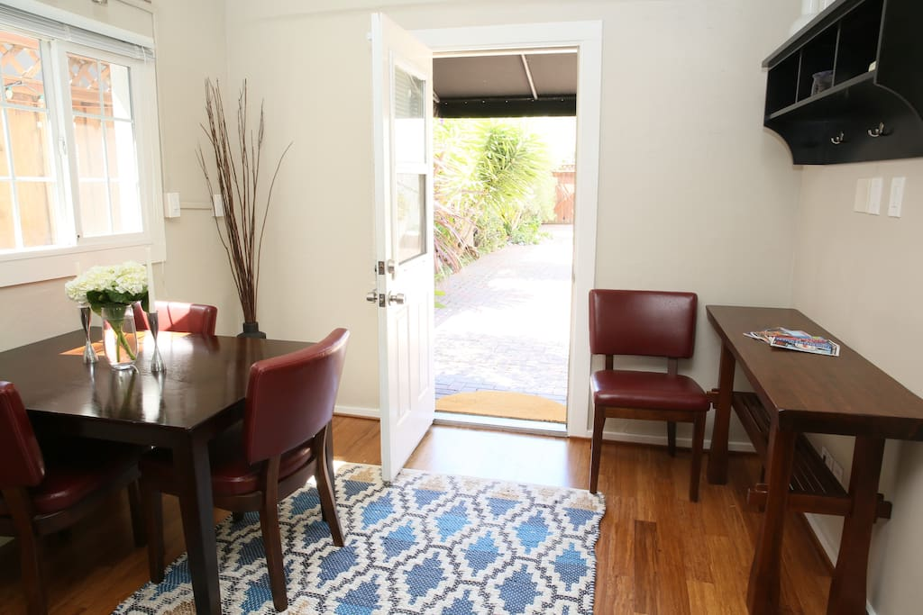 Bright entryway leads into cottage with ample tables and chairs.
