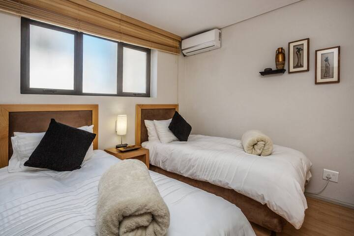 2nd bedroom with aircon & own ensuite