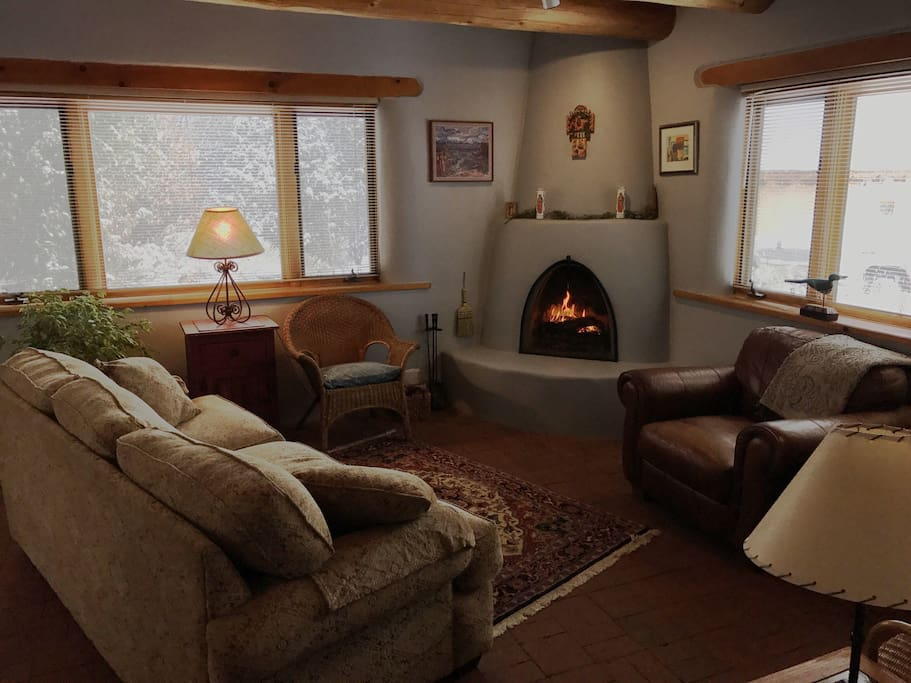 The living room with kiva fireplace (wood provided during cold months)