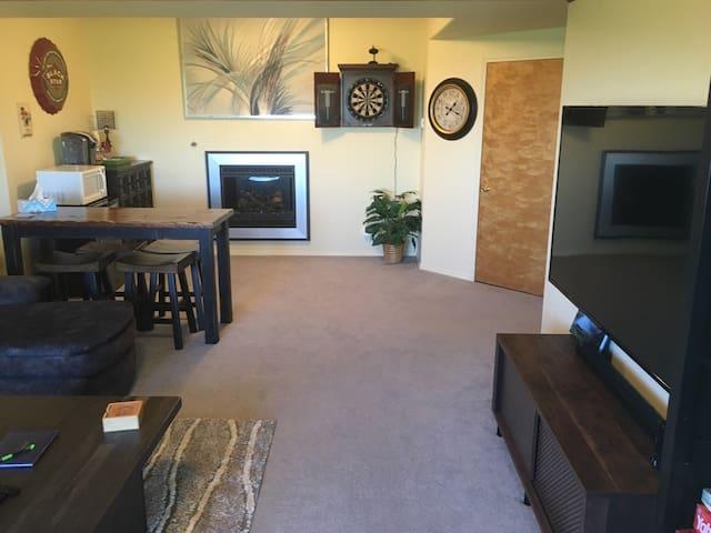 Family room: microwave, fridge, and bar in far left corner.