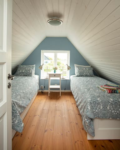 The light blue room- two twin beds with one more pull out bed underneath