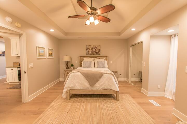 Spacious Master Bedroom with Beautiful Tray Ceiling