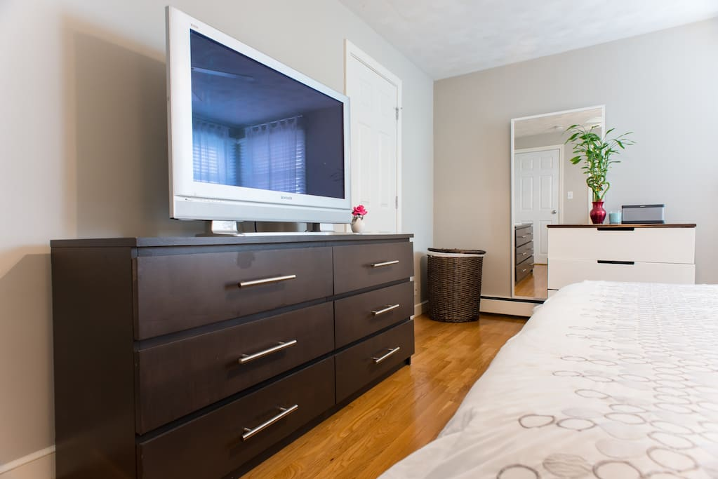 """Master bedroom with 42"""" HDTV with AppleTV"""
