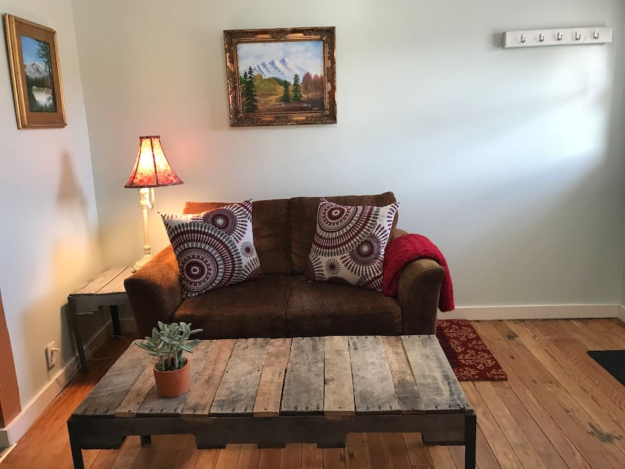 Living space with cozy love seat.