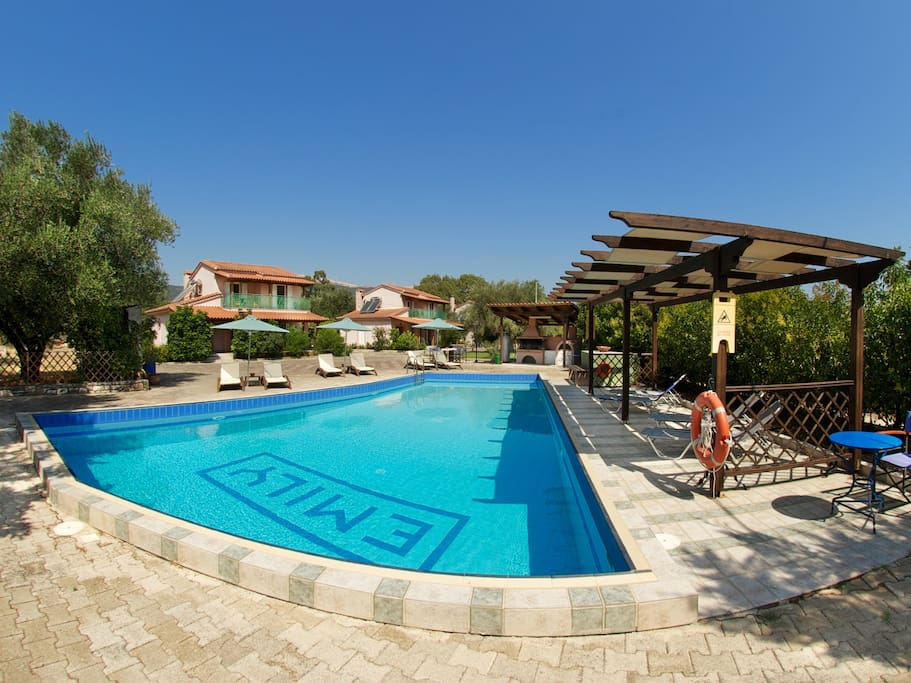 Swimming pool with umbrellas and sunbeds