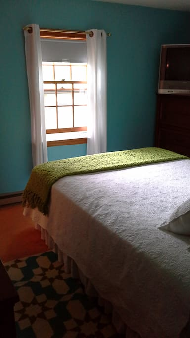 Master Bedroom-Queen Bed.  There is now an air-conditioner in the window.