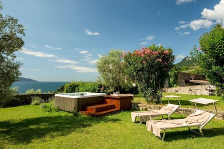 House in an antique lemon garden with private beach, jacuzzi  and big lawn