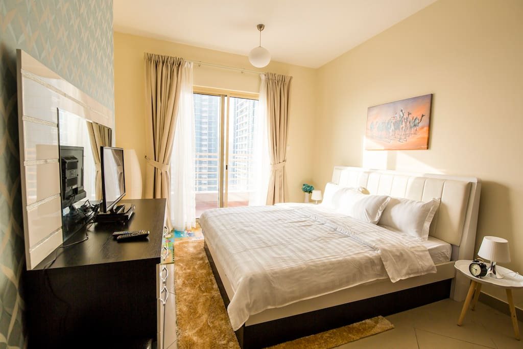 Sleep well in the large master bedroom with separate balcony, TV and DVD player. King bed (sleeps 2).