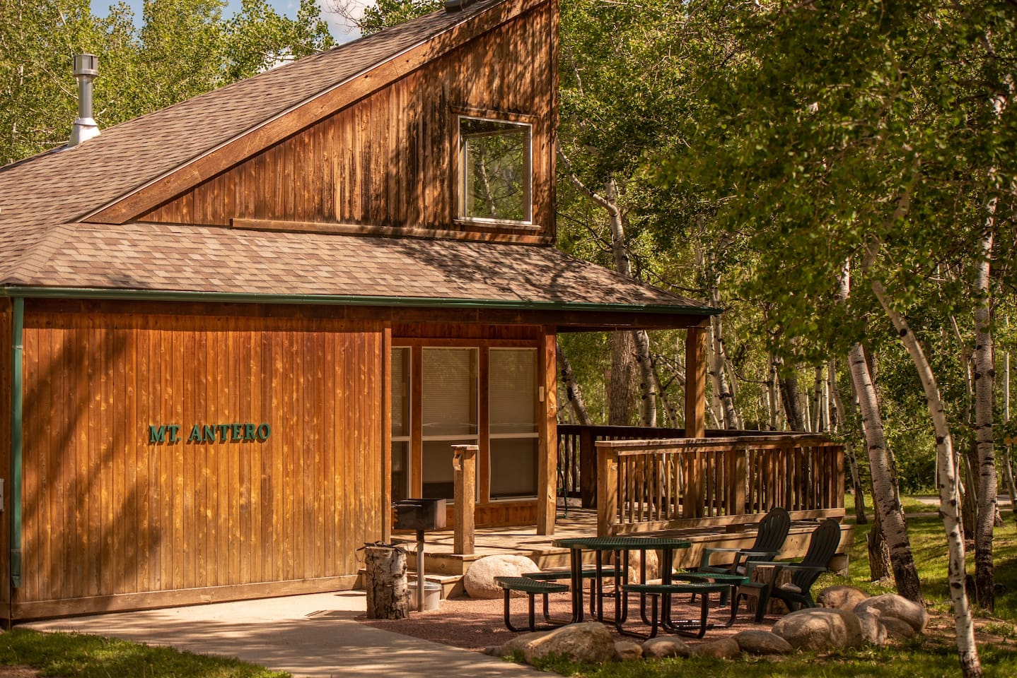 Mt. Antero Chalet is surrounded by aspen trees and has lovely views of the property from the front porch.