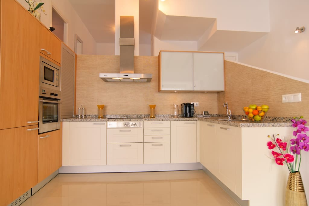 Open-plan brand new equipped kitchen
