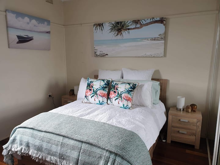 Beachside room with bus stop at front door