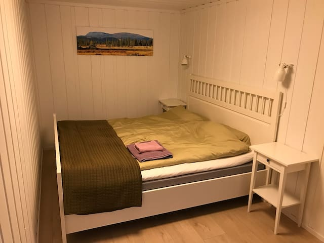 The cabin has one bedroom with a comfortable double bed.