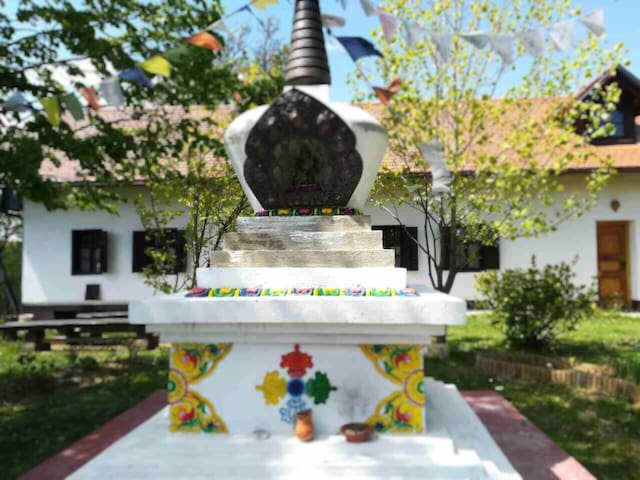 Restored Farmhouse with a Buddhist stupa