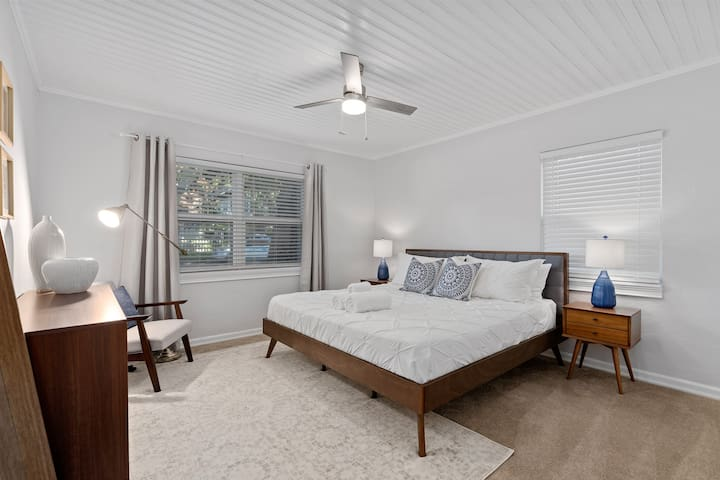 master bedroom with a large king bed and contemporary design